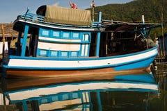 Huts and colorful  fisherboats at Royalty Free Stock Image