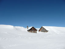 Huts in deep snow on the Alps with copy-space. Huts in deep snow on the Alps, Switzerland, with copy-space Stock Photo