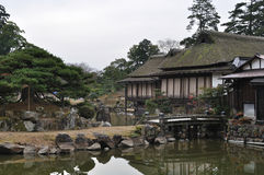Huts in the garden. Some huts standing on stilts on in a pond in the garden below Hikone Castle (Hikone-jo), Hikone, Shiga Prefecture, Japan royalty free stock images