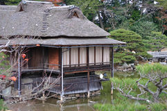 Huts in the garden. Some huts standing on stilts on in a pond in the garden below Hikone Castle (Hikone-jo), Hikone, Shiga Prefecture, Japan royalty free stock photos