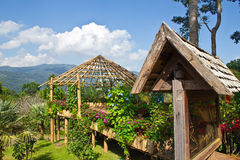 Huts in garden. Royalty Free Stock Images