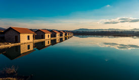 Huts by the lake Stock Images