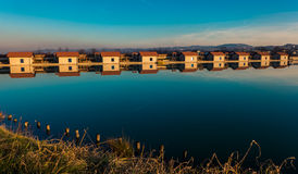 Huts by the lake Royalty Free Stock Image
