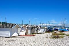 Huts on Lyme Regis beach. Stock Photo