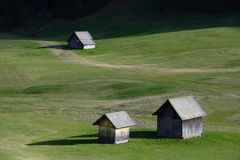 Huts on the meadow. At Prato Piazza Alto Adige Dolomites Mountains In Italy Stock Images