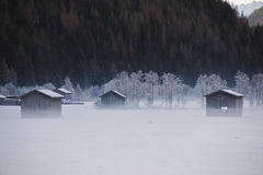 Huts in the mist Royalty Free Stock Photography