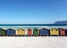 Huts on Muizenberg beach. Row of painted huts on Muizenberg beach in Cape Town, South Africa Royalty Free Stock Photography