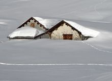 Huts nearly complete under the snow Royalty Free Stock Photo