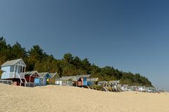 Huts On Beach At Holkham Sands, Norfolk Stock Photo