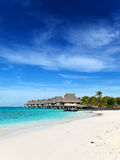 huts over the blue ocean Stock Photography