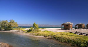 Huts on picturesque beach. Wooden huts on picturesque beach next to town of Loreto, Baja California Sur, Mexico Stock Photos