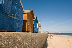 Huts and pier. Beach huts on the sea front at Cromer with the pier in the distance royalty free stock photos