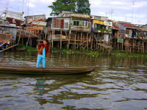 Huts by the river. Mekong delta on boat shanty huts on stalks by river stock photos