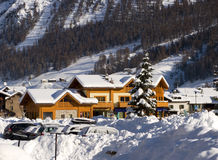 Huts with snow. Livigno huts witha lot of white snow Stock Image