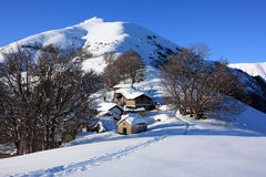 Huts with snow. Wonderful winter view of mountain with hut and snow Stock Photo