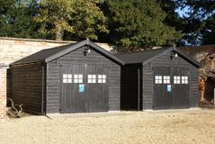 Huts.  storage. Facade or exterior of two huts or storages Stock Photos