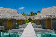 Huts at the topical resort at Maldives. Huts at the topical resort Royalty Free Stock Photography