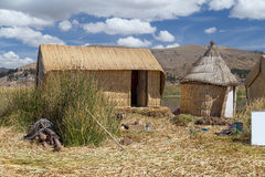 Huts at Uros floating island and village on Lake Titicaca near Puno,  Peru Royalty Free Stock Photography
