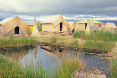 Huts on Uros floating islands. Royalty Free Stock Photos