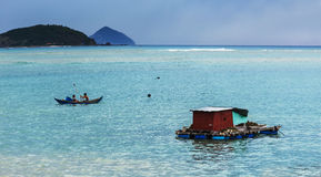 The huts of Vietnamese fishermen on the water Stock Photos