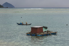 The huts of Vietnamese fishermen on the water Royalty Free Stock Photography