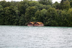 Huts on the water. Two huts on the water Stock Photos