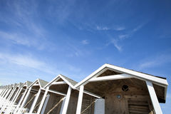 Huts wooden roofs. Blue sky with few clouds. HDR Stock Images
