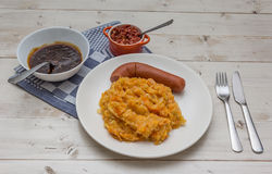 Hutspot with smoked sausage on a white plate Stock Images