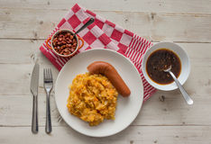 Hutspot with smoked sausage on a white plate Royalty Free Stock Image