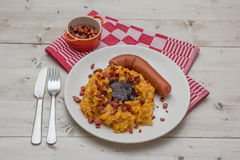 Hutspot with smoked sausage on a white plate Stock Photography