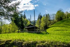 Hutsul hay barn on a green field royalty free stock images