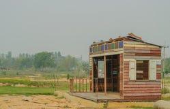 Hutte de bois de construction en construction Images stock