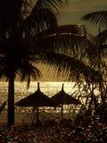 Huttes au coucher du soleil Photos stock