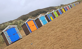 Huttes colorées de plage Photographie stock