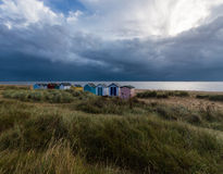 Huttes colorées de plage chez Southwold Image libre de droits