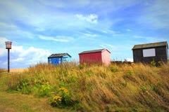 Huttes colorées Littlestone Kent R-U de plage Images libres de droits