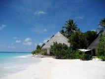 Huttes dans la plage Photographie stock libre de droits