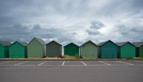 Huttes de plage sous des nuages Photo stock