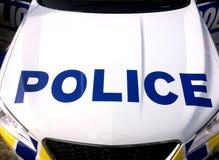 Huv för hätta för medel för polisbil Arkivbild