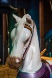 Huvud av den vita hästen från karusell Arkivbilder