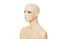 Huvud av en kvinnlig skyltdocka i profil som isoleras på vit arkivfoton