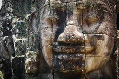 Huvud Staute av den Bayon templet i Angkor Thom Arkivfoto