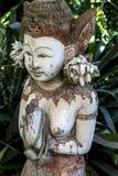 Huvudet och kroppen av en årig gudinna för buddistisk tempel 100 Fotografering för Bildbyråer