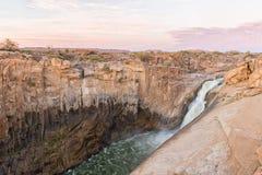 Huvudsaklig Augrabies vattenfall på solnedgången Fotografering för Bildbyråer