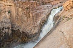 Huvudsaklig Augrabies vattenfall på solnedgången Arkivfoto