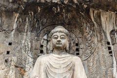 Huvudsaklig Buddhastaty i den Fengxiangsi grottan, Luoyang, Kina Royaltyfri Fotografi