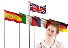 huvudsakliga språkflaggor bak att tänka för tonåring Royaltyfria Bilder