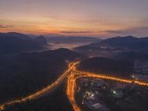 Huvudväg för Rawang förbikopplingsförbikoppling på `-Rawang selangor ` under soluppgång Royaltyfria Bilder