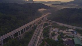 Huvudväg för Rawang förbikopplingsförbikoppling på `-Rawang selangor ` under soluppgång Royaltyfria Foton