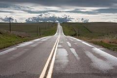 Huvudväg in i molnen Royaltyfria Foton